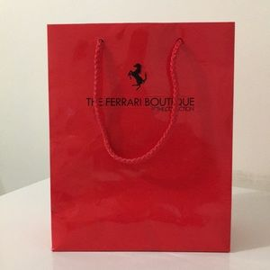 the ferrari boutique at the collection red bag